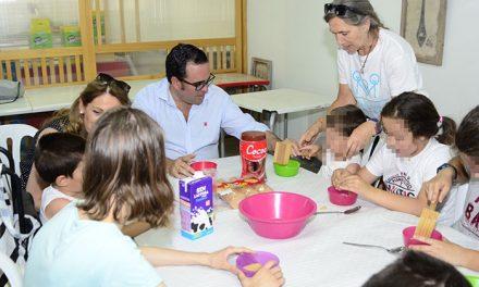 Juegos, talleres, hípica y piscina en el campamento dirigido a menores con discapacidad funcional